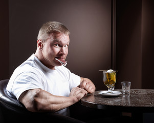 Happy muscular man and tea