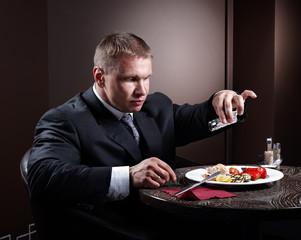 Muscular businessman eating