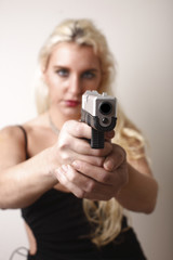 Sexy woman with pistol