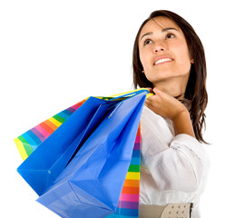 Pensive woman with shopping bags isolated
