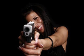 Woman aiming pistol