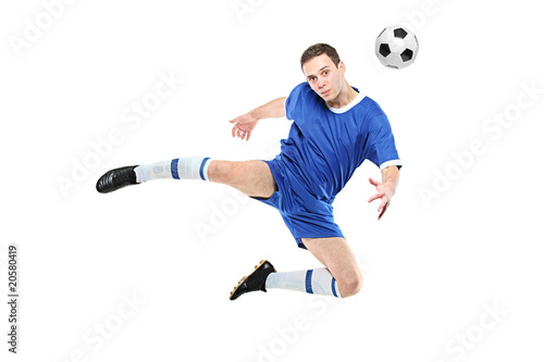 Soccer player with a ball in jump isolated on white background