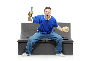 Excited man watching sport isolated on white