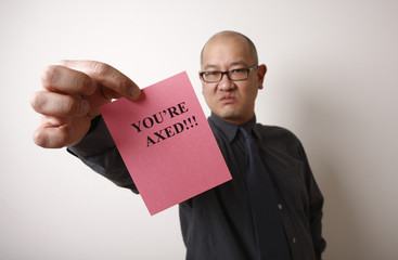 An unpleasant employer handing out pink slips.