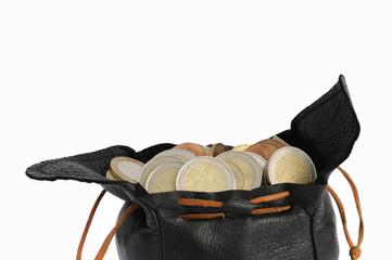 porte monnaie rempli de pièce