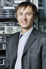 Portrait of young data center specialist in front of equipment