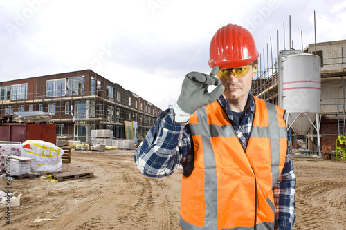 Saluting construction worker