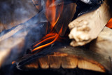 Flames and glow in a wood burner poster