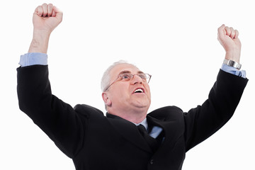 senior business man standing with fists clenched in victory
