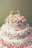 Wedding cake adorned with fresh pink roses. poster