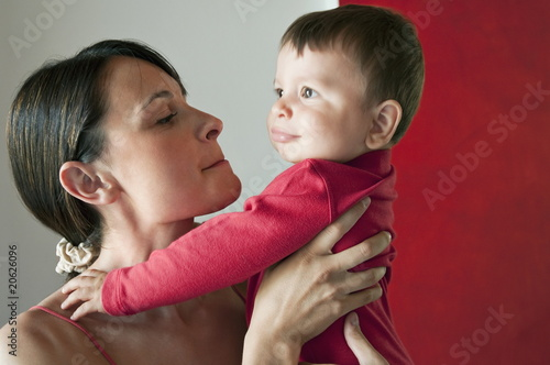 Young woman holding baby boy