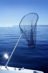 Fishing scoop net on boat in blue sea