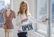 Leinwandbild Motiv Shopkeeper holding open sign