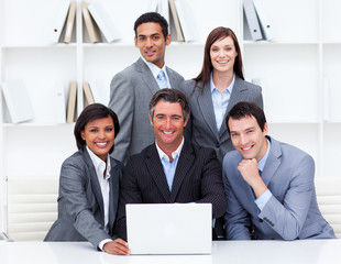 Successful business team looking at a laptop