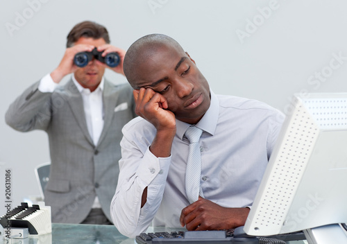 Unhappy businessman getting bored and his manager looking throug