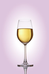 Glass with white wine on a rose background