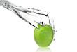 fresh water splash on green apple isolated on white