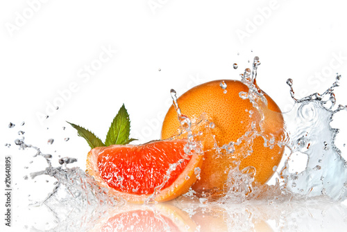 Water splash on grapefruit with mint isolated on white © artjazz