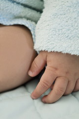 Closeup of baby's hand and thigh