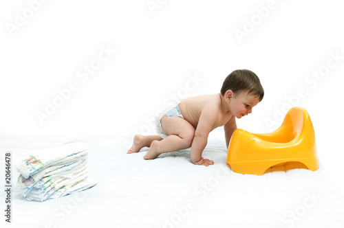 Baby boy with diapers and potty