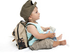 Baby boy with backpack and map