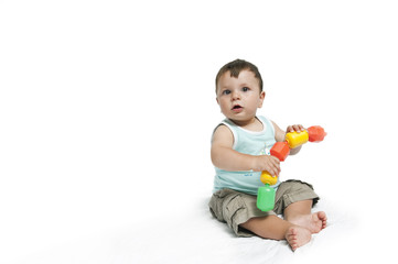 Baby boy playing with connecting blocks