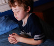 young boy praying