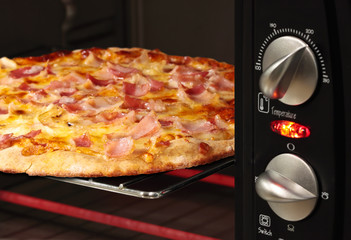 pizza being cooked  in oven - shallow DOF