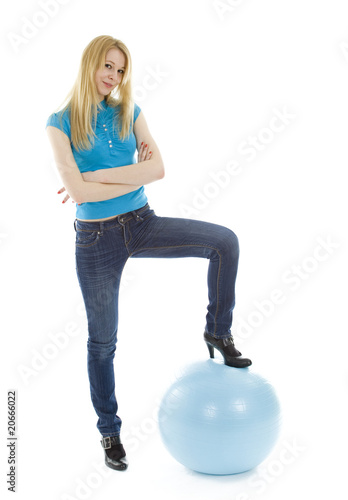 Girl on blue ball isolated on white background.