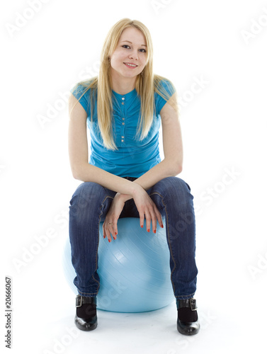 smiling young woman on blue ball