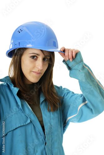 jeune femme avec casque de travail bleu photo libre de. Black Bedroom Furniture Sets. Home Design Ideas