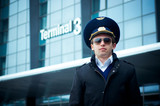 young pilot in Kastrup airport against terminal three, copenhage