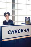 airport personal at check-in desk at the departures in the airpo
