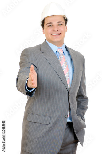 Handsome businessman saying welcome on white