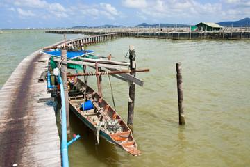 Bridge to fisherman house in Thai sea