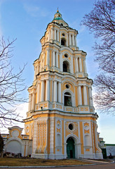 Antique stone baroque bell tower in Ukraine