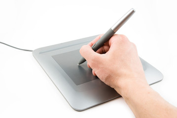 digital tablet and pen in a hand