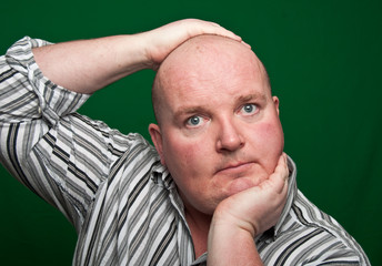 portrait close up of overweight male on green screen