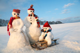 snowman family with sled