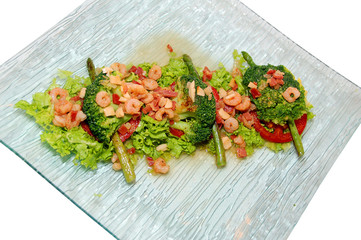 salad with prawn and vegetables on the plate