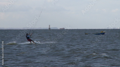 Kitesurfer in action jumping