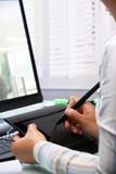Female graphic designer using tablet pen poster