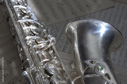 Saxophone and old sheet music