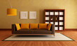 modern couch and wood bookcase in a living room