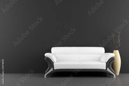 white sofa and vase with dry wood in front of black wall