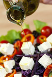 Olive Oil Dressing Pouring Onto Fresh Salad poster