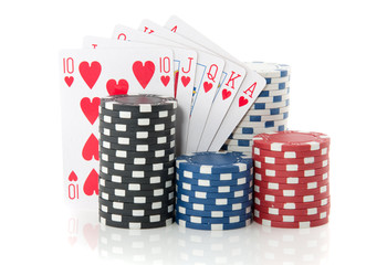 colorful gambling chips and cards for casino games isolated over