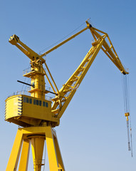 Yellow Harbour crane against the blue sky