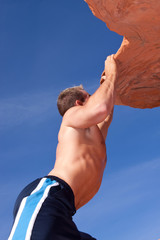Athletic male rock climber