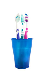 Tooth brushes are in blue glass